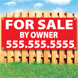Wood fence displaying a banner saying 'FOR SALE BY OWNER & phone #' in white text on a red background