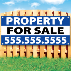 Wood fence displaying a banner saying 'property' in white text on a blue background and 'FOR SALE' in black Text on White Background