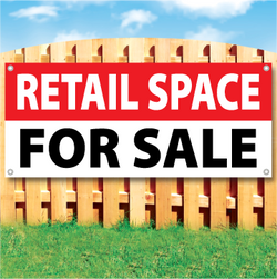 Wood fence displaying a banner saying 'RETAIL SPACE' in white text on a red background and 'FOR SALE' in black Text on White Background