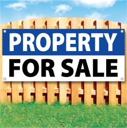 Wood fence displaying a banner saying 'PROPERTY SPACE' in white text on a blue background and 'FOR SALE' in black Text on White Background