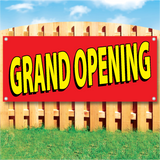 Wood fence displaying a banner saying 'GRAND OPENING' in yellow text on a red background