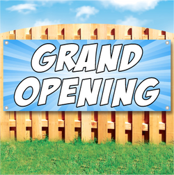 Wood fence displaying a banner saying 'GRAND OPENING' in white text on a blue background
