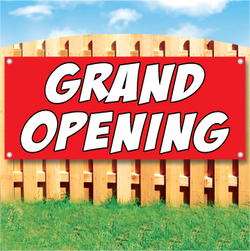 Wood fence displaying a banner saying 'GRAND OPENING' in white text on a red background