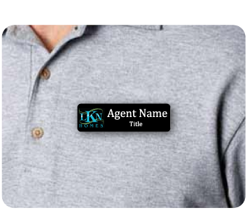 Name badge with LKN Homes logo and agent name displayed on agent shirt