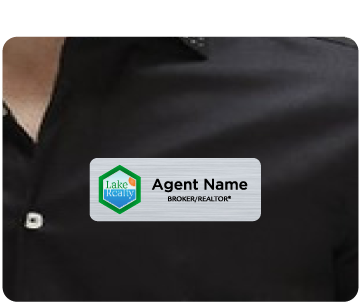 Name badge with Lake Realty logo and agent name displayed on agent shirt