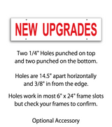 "Sign rider with 4 holes saying ""NEW UPGRADES"" in red print"