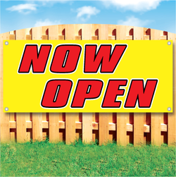 Wood fence displaying a banner saying 'Now Open' in red text on a yellow background