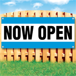 Wood fence displaying a banner saying 'Now Open' in black text on a white background with blue stripes