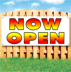 Wood fence displaying a banner saying 'Now Open' in red and yellow text on a white background