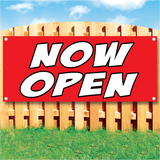 Wood fence displaying a banner saying 'NOW OPEN' in white text on a red background