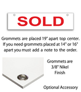 "Sign rider with 2 grommets on top saying ""SOLD"" in red print"
