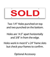 "Sign rider with 4 holes saying ""SOLD"" in red print"