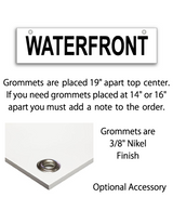 "Sign rider with 2 grommets on top saying ""WATERFRONT"" in black print"