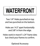 "Sign rider with 4 holes saying ""WATERFRONT"" in black print"