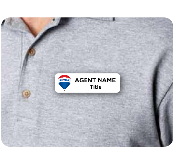 Name badge with REMAX logo and agent name displayed on agent shirt