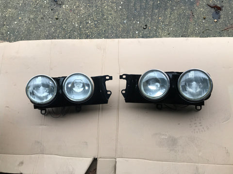 Jaguar X300 headlamp set L&R with surrounds black