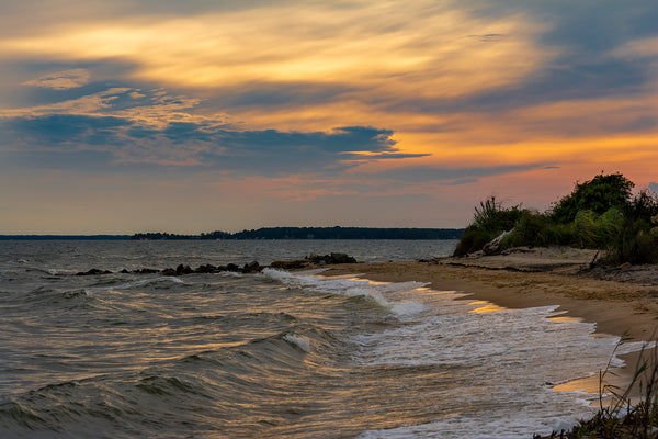 A colorful sky and high winds along the shores of the aptly named Windmill Point, Virginia.