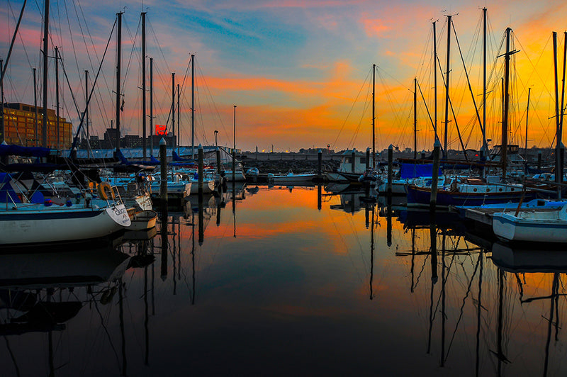 A magnificent sunset is captured at the Harbor East Marina in Baltimore, Maryland.