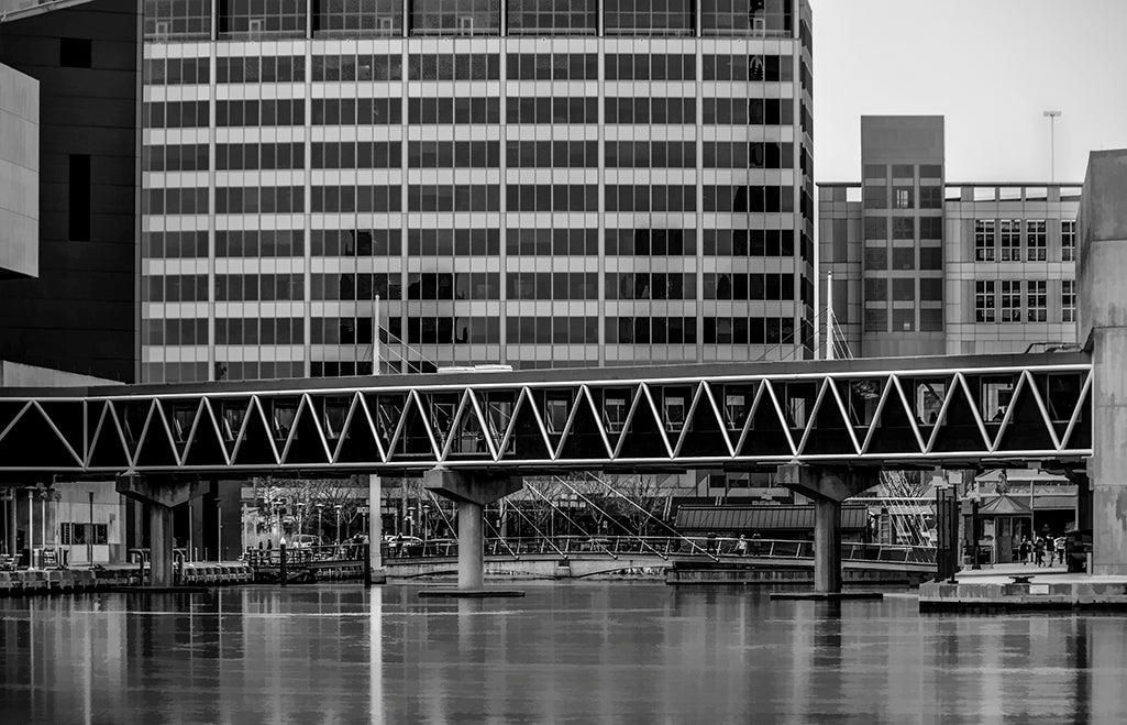 A footbridge connects two sections of the National Aquarium in Baltimore, spanning piers 3 and 4.