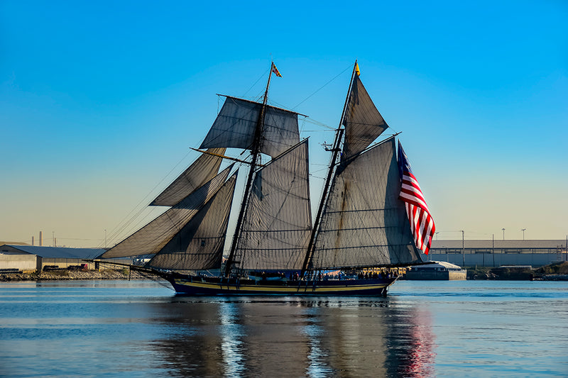 The Pride of Baltimore II sails up the Patapsco River in Baltimore.