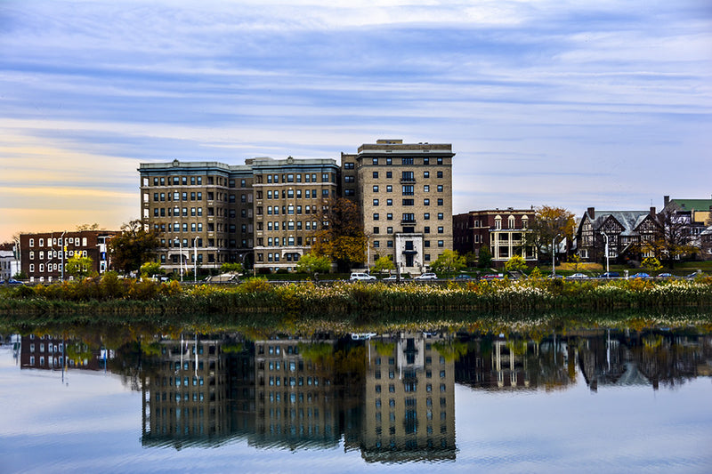 The historic Riviera and Chateau apartments in Baltimore provide a reflective moment on Druid Lake.