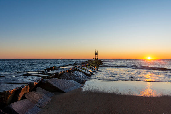 The sunrises near the rock jetty at the Indian River Inlet in Dewey Beach, Delaware.