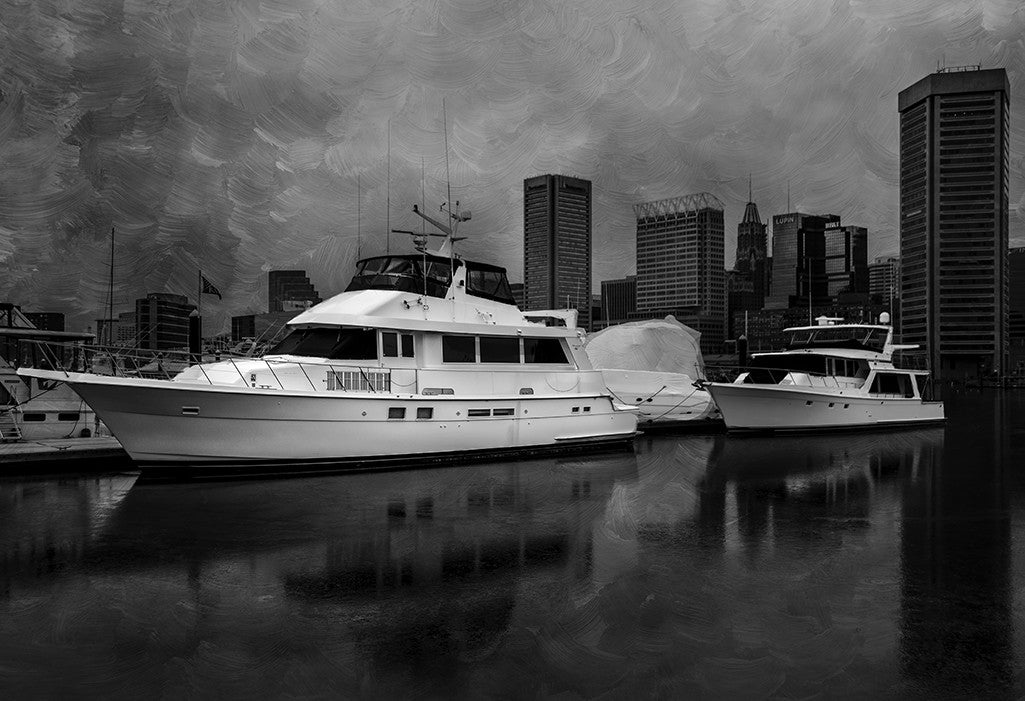 Black and white photograph of some yachts docked in the Baltimore Harbor.