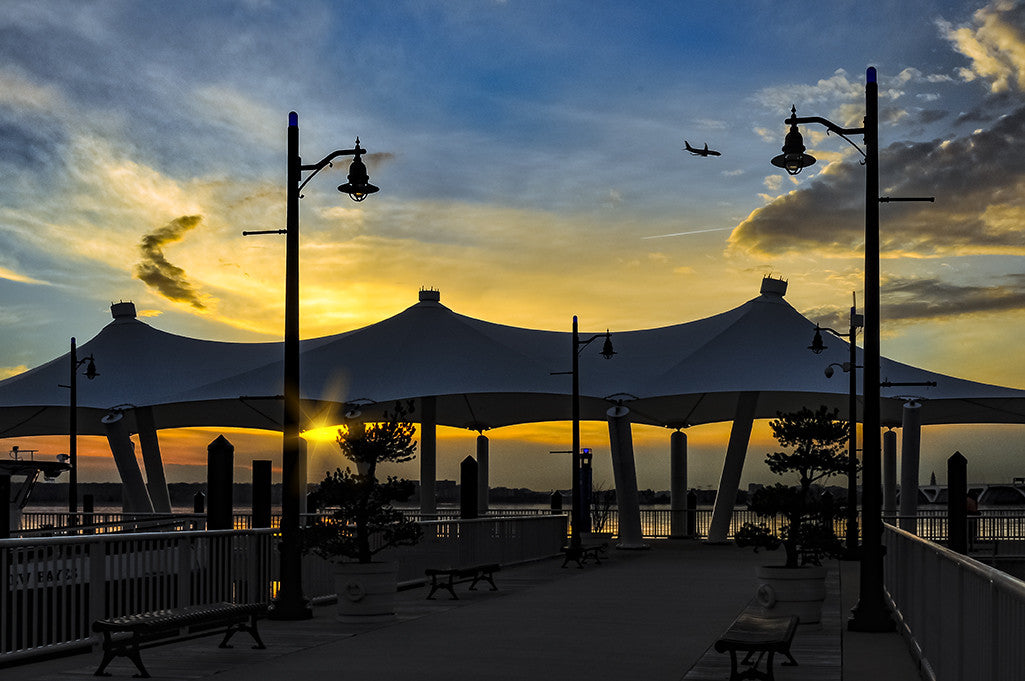 A beautiful sunset peeks beneath a canopy at National Harbor, Maryland.