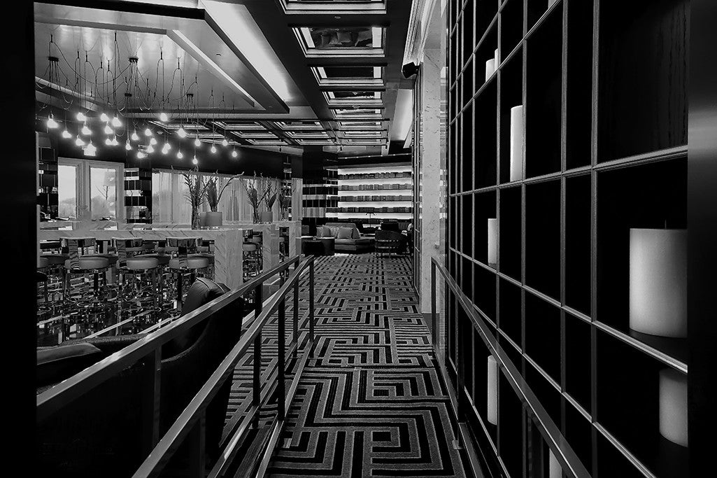 Patterns and lines converge in this black and white fine art photograph of a fine dining establishment.