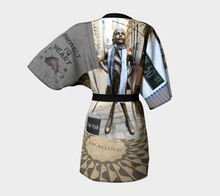 Fearless Girl wears ealanta, Imagine,50th, NYC collage Kimono Robe- ealanta Art Wear