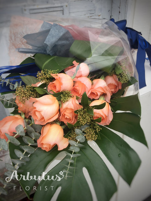 One dozen peach roses