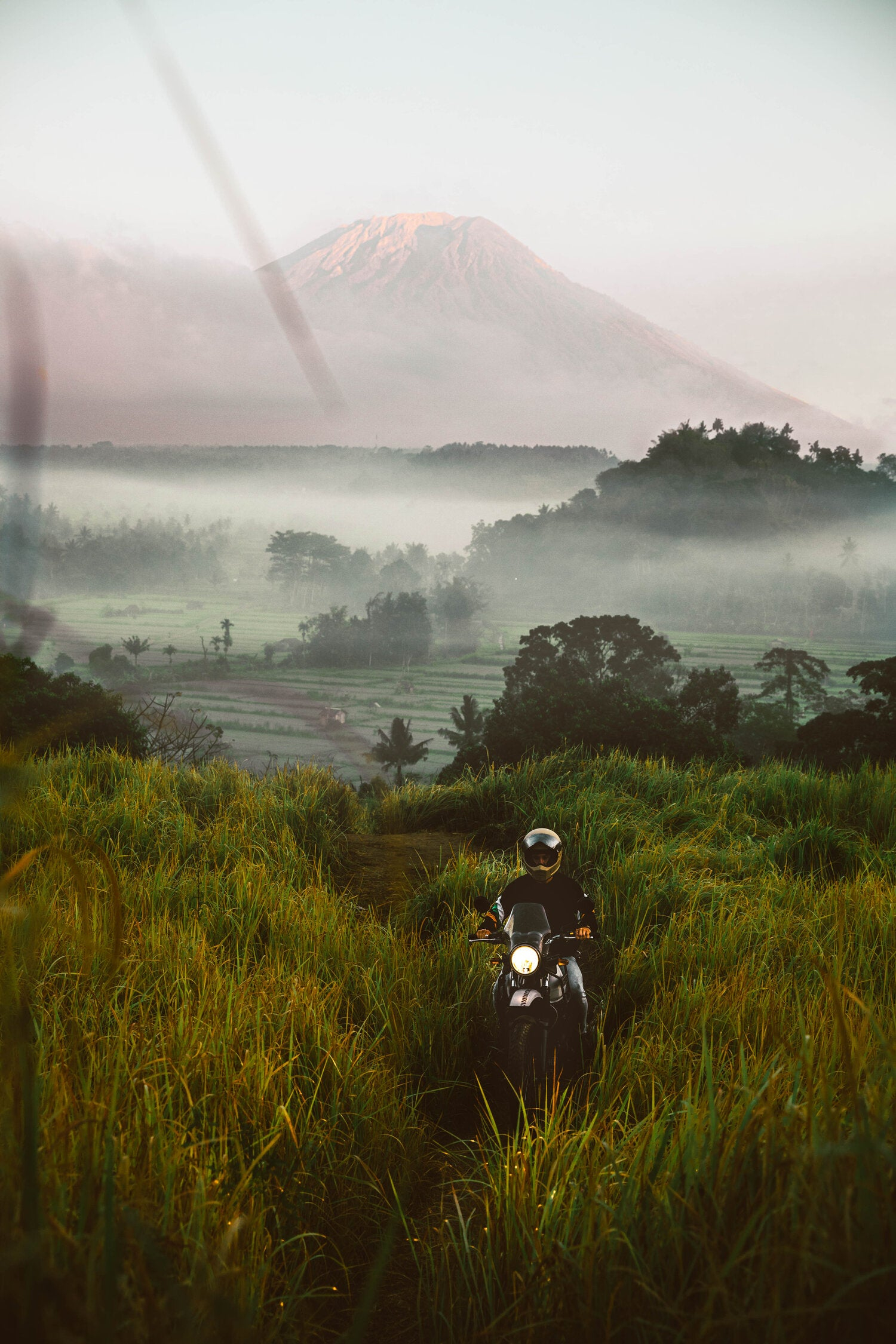 Lost LeBlanc on scooter with Mount Agung in background, Bali