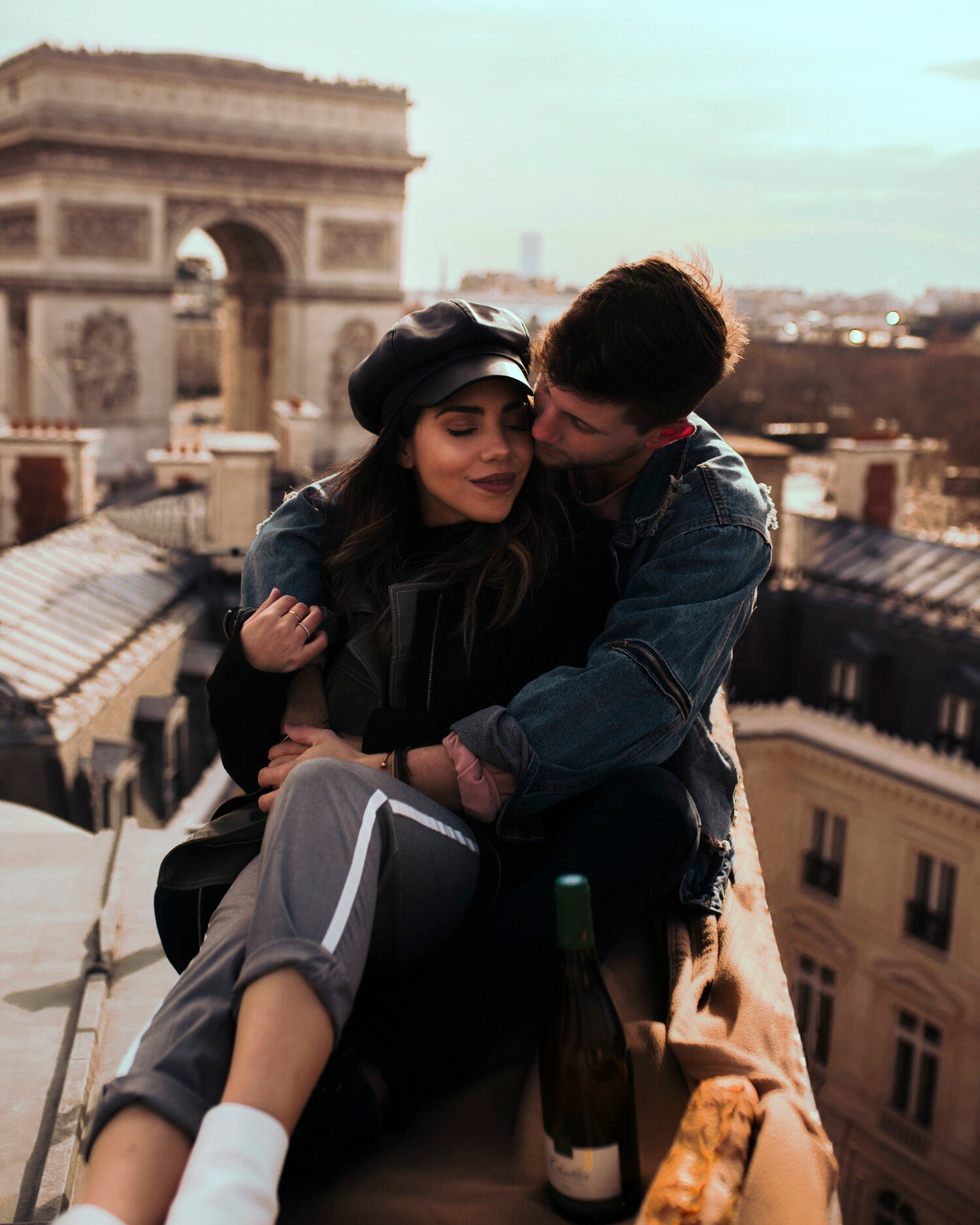 WhatTheChic and Lost LeBlanc on rooftop in Paris with Arc de Triomphe behind