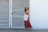 "Kirana WANDA 15"" large brim hat in Tan worn with KALANI flounce dress in Sangria, AVALON sandals & POPPY beaded tote in Natural"