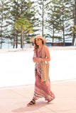 "Kirana MARIE-CLAIRE maxi dress worn with ELY sandals in Dark-Chocolate, WANDA 15"" brim hat in Tan & POPPY beaded tote bag in Tan"