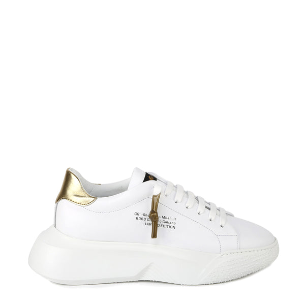 Sneakers nemesis in nappa con riporto in pelle color oro | Woman