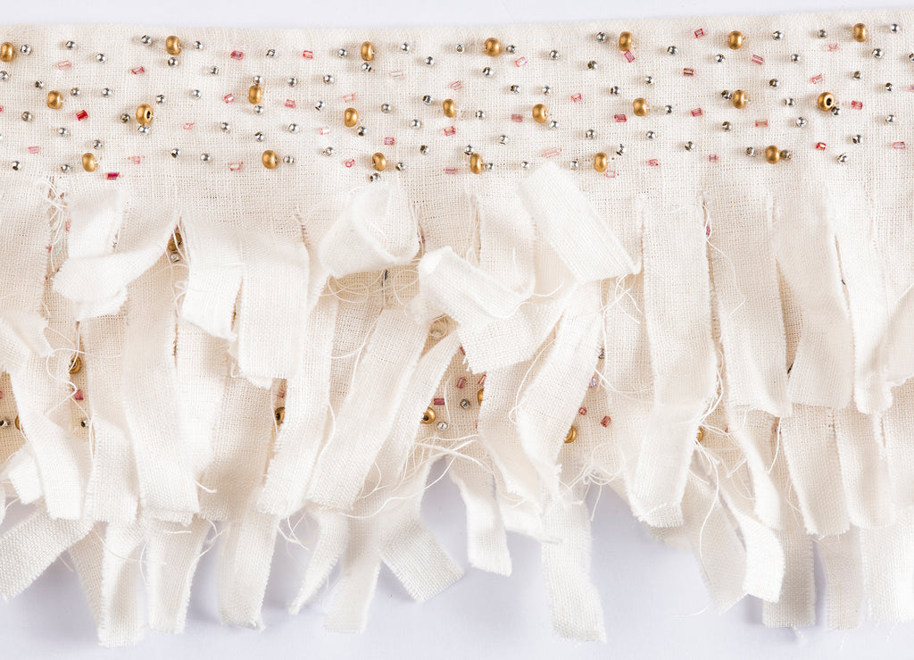 """Shipwrecked"" trim from The Queens Conquest, designed by Michelle Workman for Pyar&Co. This gorgeous flowing white trim features delicate hand-beading. Sold by yard for use on curtains, home accessories, and upholstery, this trim is unique and versatile in its application."