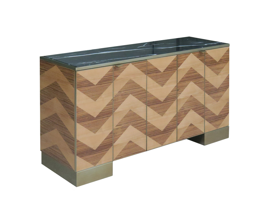 A unique, herringbone buffet with a black marble top. Perfect for all your entertaining and storage needs! This piece is available in the smaller size with a light Zebrawood finish and in the larger size with a Rosewood finish. This piece from The Facet Collection was designed by Michelle Workman for French Heritage and is perfect for anyone looking to achieve that luxurious, high-end look in their home. Shown here in the smaller-sized, light Zebrawood finish.