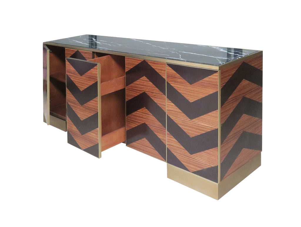 A unique, herringbone buffet with a black marble top. Perfect for all your entertaining and storage needs! This piece is available in the smaller size with a light Zebrawood finish and in the larger size with a Rosewood finish. This piece from The Facet Collection was designed by Michelle Workman for French Heritage and is perfect for anyone looking to achieve that luxurious, high-end look in their home. Shown here in the larger-sized, Rosewood finish.