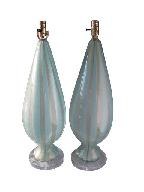 "A stunning pair of urn-shaped Murano glass lamps in crystal and turquoise stripe (""sticks"") with 24k gold flecks and set on circular acrylic bases. From the now-closed Barbini Factory in Murano, Italy, circa 1955. Perfect for the vintage glass collector or an individual looking to achieve that luxurious, high-end look in their home."