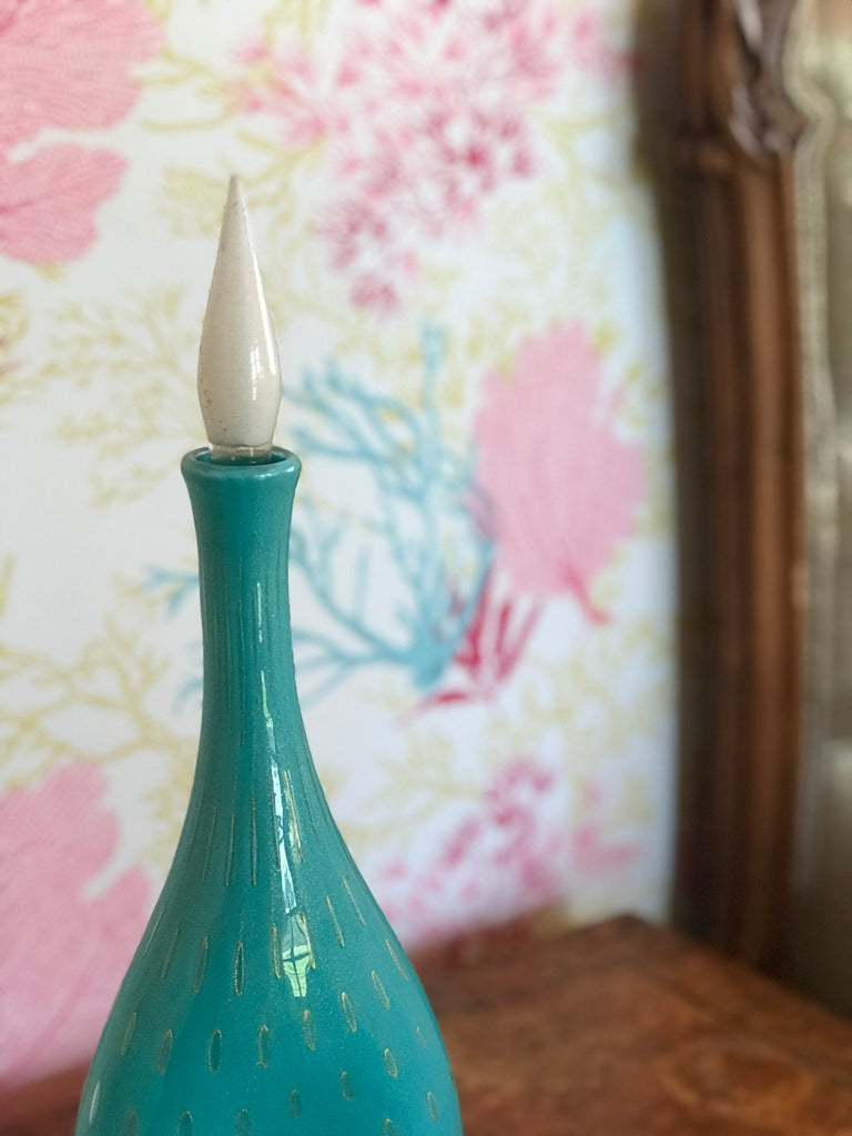 Large, turquoise decanter with 24k gold flecks and controlled bubbles from the now-closed Barbini Factory in Murano, Italy, circa 1955. Signed by Alfredo Barbini.  Perfect for the vintage glass collector or an individual looking to achieve that luxurious, high-end look in their home.