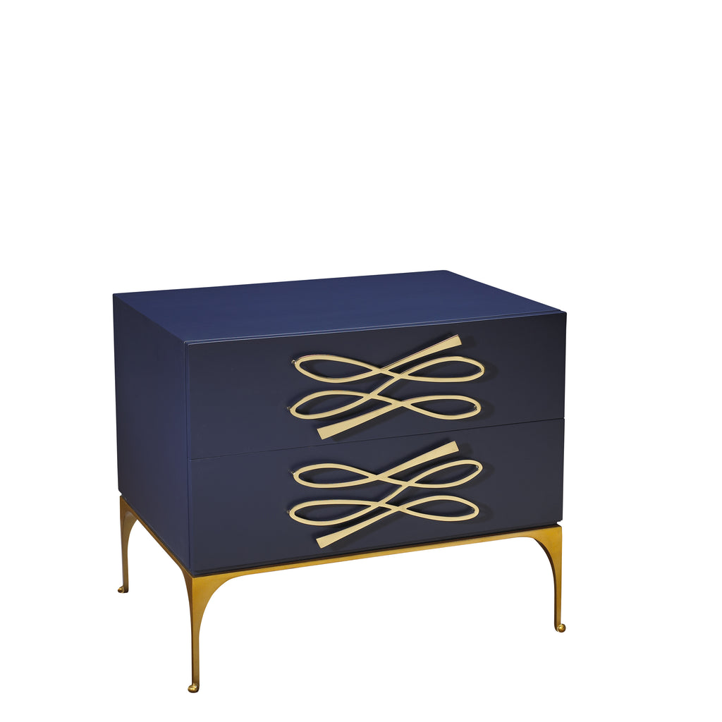 As seen in the 2017 Traditional Home Dallas Showhouse, the Tuxedo Nightstand is crisp and stylish with accentuated hand cast solid brass hardware and base. This piece comes in 2 of our signature colors: Vanilla or Midnight Blue. Designed by Michelle Workman for French Heritage and perfect for anyone looking to achieve that luxurious, high-end look in their home. Shown here in the Midnight finish.