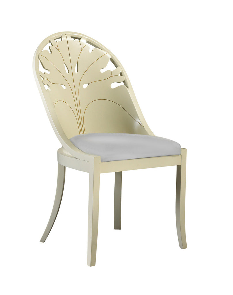 The Pink Lady Side Chair is sure to add flare to your dining room set-up! This piece from The Facet Collection was designed by Michelle Workman for French Heritage and is perfect for anyone looking to achieve that luxurious, high-end look in their home. Shown here in the Vanilla finish.