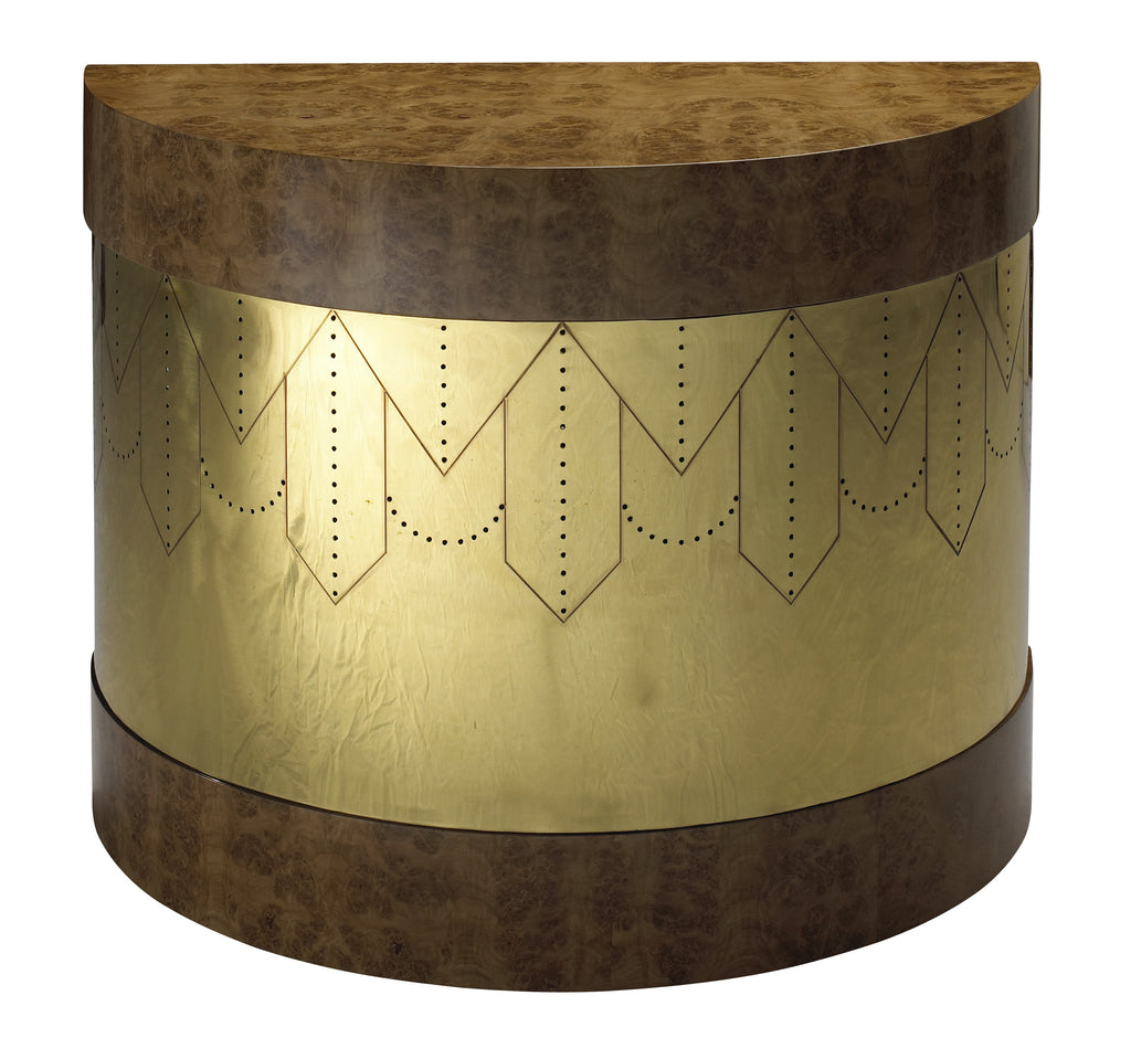 As seen on the cover of Lighting & Decor magazine's July 2017 issue, this crescent shaped side table is available in a light burl and brass, a medium burl and brass, or a rosewood and ebony with copper finish. This piece from The Facet Collection was designed by Michelle Workman for French Heritage and is perfect for anyone looking to achieve that luxurious, high-end look in their home. Shown here in the medium burl and brass option.