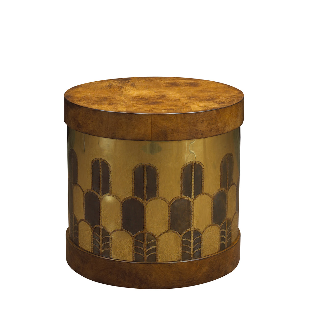 The Gibson Side Table has a hatbox-inspired form and is beautifully hand-etched in Deco design on brass or copper. The top and base are finished in burl, rosewood or lacquer. This piece from The Facet Collection was designed by Michelle Workman for French Heritage and is perfect for anyone looking to achieve that luxurious, high-end look in their home. Shown here in the midtone Burl and brass finish.