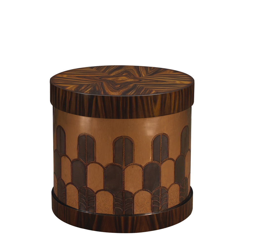 The Gibson Side Table has a hatbox-inspired form and is beautifully hand-etched in Deco design on brass or copper. The top and base are finished in burl, rosewood or lacquer. This piece from The Facet Collection was designed by Michelle Workman for French Heritage and is perfect for anyone looking to achieve that luxurious, high-end look in their home. Shown here in the Rosewood and copper finish.
