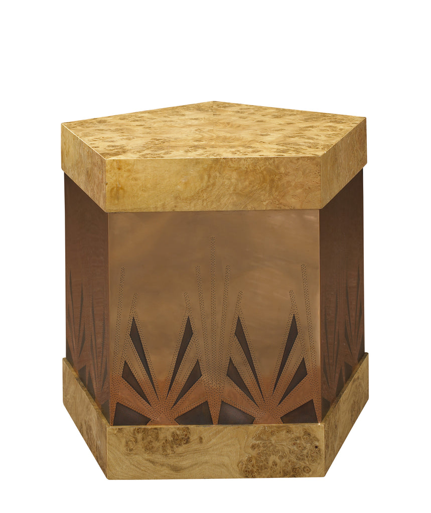 The Ramos Fizz Side Table, with hand-perforated, solid brass or copper body and pentagonal hat-box form top and base, is a stunning take on the Art Deco movement. This piece from The Facet Collection was designed by Michelle Workman for French Heritage and is perfect for anyone looking to achieve that luxurious, high-end look in their home. Shown here in the light Burl and copper finish option.