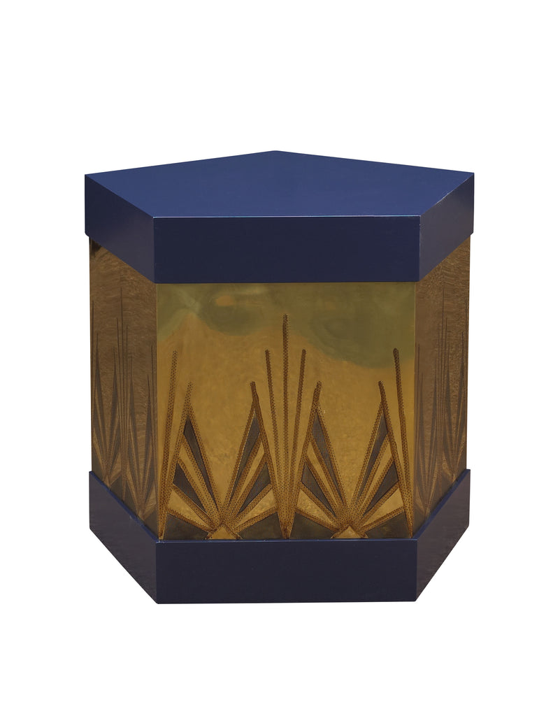 The Ramos Fizz Side Table, with hand-perforated, solid brass or copper body and pentagonal hat-box form top and base, is a stunning take on the Art Deco movement. This piece from The Facet Collection was designed by Michelle Workman for French Heritage and is perfect for anyone looking to achieve that luxurious, high-end look in their home. Shown here in the Midnight blue and brass finish option.