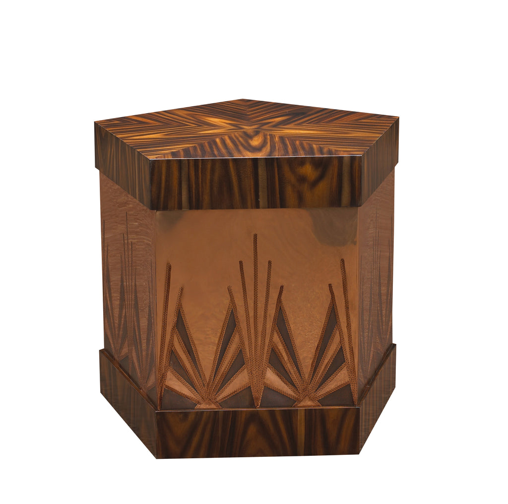 The Ramos Fizz Side Table, with hand-perforated, solid brass or copper body and pentagonal hat-box form top and base, is a stunning take on the Art Deco movement. This piece from The Facet Collection was designed by Michelle Workman for French Heritage and is perfect for anyone looking to achieve that luxurious, high-end look in their home. Shown here in the Rosewood and copper finish option.