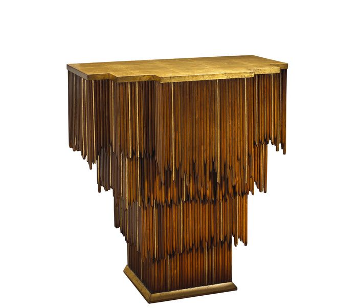 The Mai Tai Entry Table features a cascading form of mahogany and gold trim, as well as a gold leaf top and base. This piece from The Facet Collection was designed by Michelle Workman for French Heritage and is perfect for anyone looking to achieve that luxurious, high-end look in their home. The standard top option is shown here.